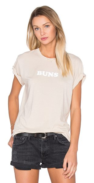 The Laundry Room Buns Rolling Tee in beige - 60% cotton 40% poly. Front graphic print. Raw cut edges....