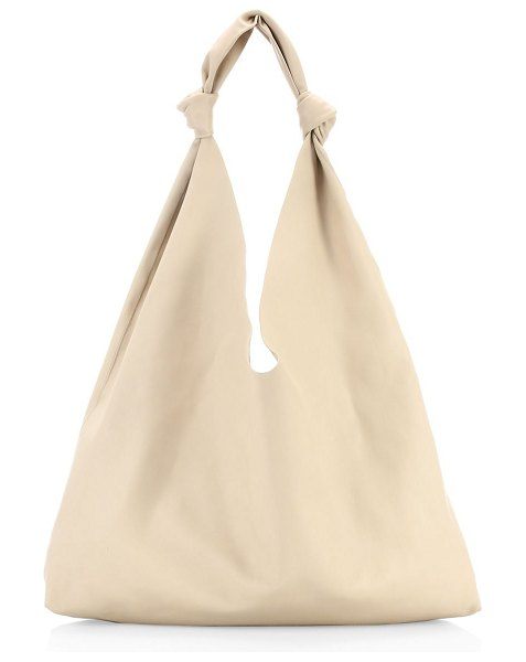 The Row bindle double knot leather hobo bag in eggshell - Bohemian supple leather hobo bag with double knotted...