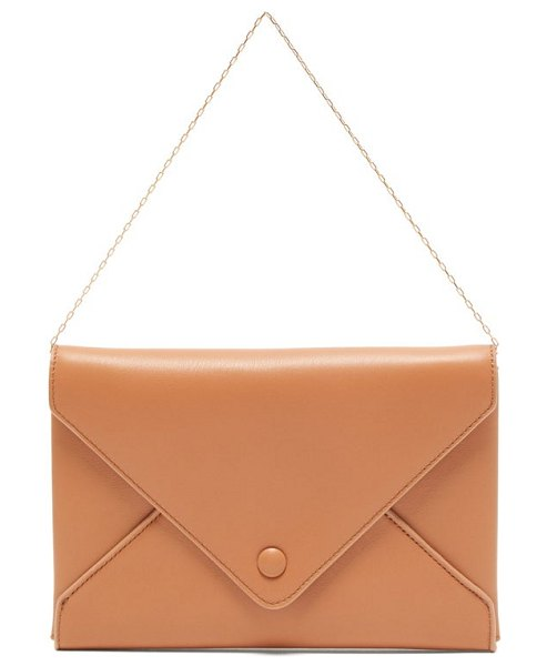 The Row envelope leather clutch in coral