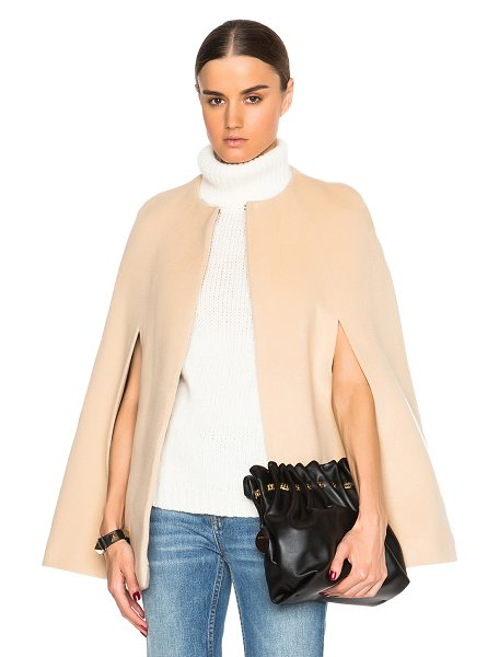ThePerfext Mercer cape in neutrals - ThePerfext is a collaboration between Elyse Walker and...