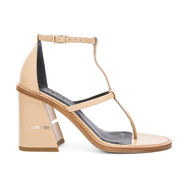 Tibi Chloe sandal in beige - Leather upper and sole. Ankle strap with buckle closure....