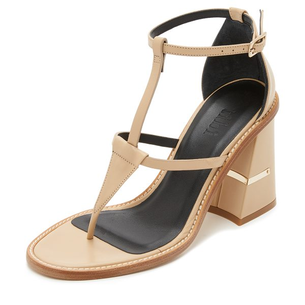 Tibi Chloe sandals in nude - A metallic plate accents the geometric covered heel on...
