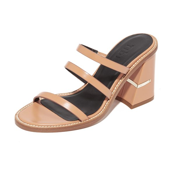 Tibi mela mules in tearose - Slim, asymmetrical straps compose these smooth leather...