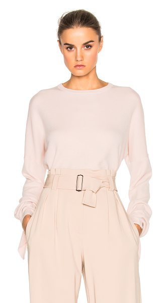 Tibi Mock Tie Sleeve Sweater in pink - Tibi is a New York based advanced contemporary brand...