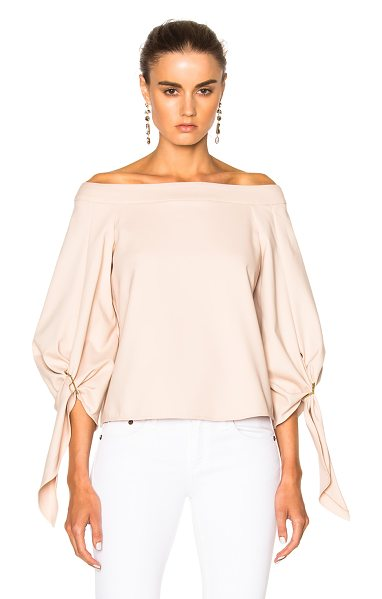 Tibi Off Shoulder Sculpted Top in pink - Tibi is a New York based advanced contemporary brand...