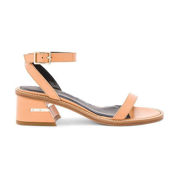 """Tibi Peyton Sandals in tan - """"Leather upper and sole. Wrap ankle with buckle closure...."""