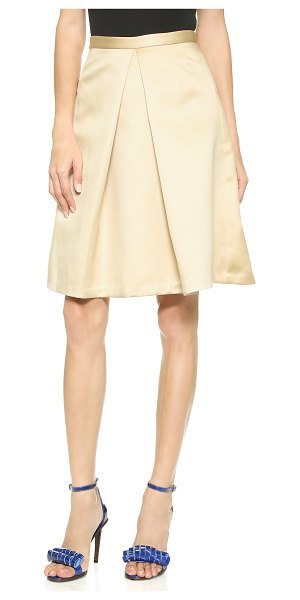 Tibi Pleated skirt in beige - Deep pleats sculpt the feminine profile of this A line...