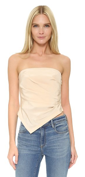 Tibi Pleated strapless top in morro sand - Crisp pleats fan from the side seam on this strapless...