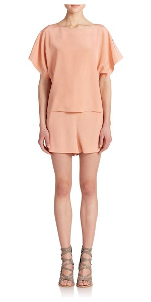 Tibi Silk short jumpsuit in momopeach - A creamy hue and fluttery sleeves enhance the femininity...