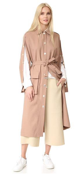 Tibi trench coat in hazelnut - Large brushed snaps run down the placket and split...