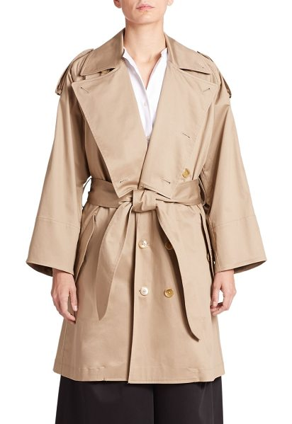 TOME Oversized short stretch-cotton trench coat in beige - Crafted in luxe stretch cotton, the iconic trench is...