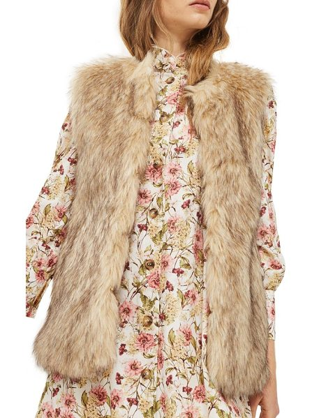 Topshop faux fur vest in brown - Plush faux fur in a rich, neutral finish transforms this...
