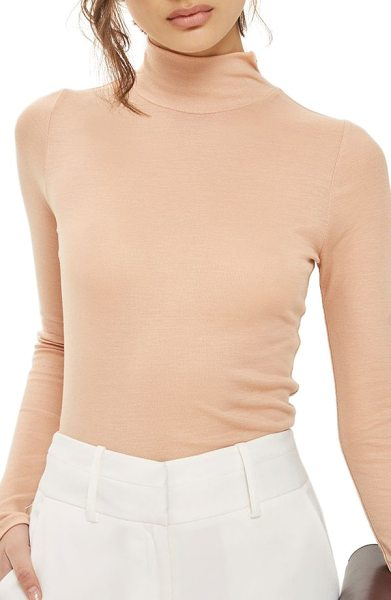 Topshop ribbed turtleneck top in nude - Simple yet chic, this slim-fitting turtleneck is a...