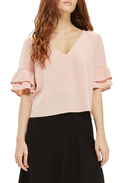 Topshop tie back ruffle sleeve top in blush - Layered ruffled cuffs and a grosgrain ribbon are the...