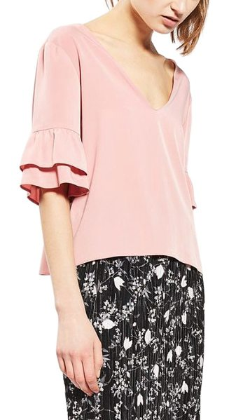 TOPSHOP tie back ruffle sleeve top in pink - Layered ruffled cuffs and a grosgrain ribbon are the...