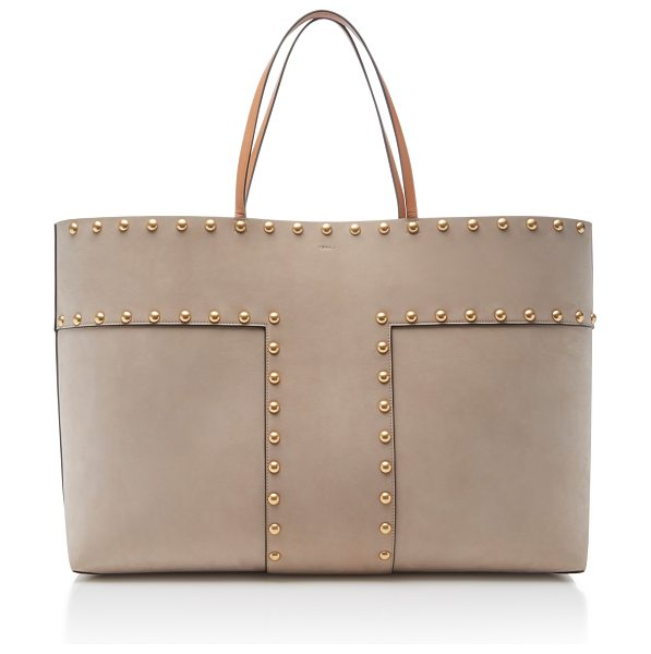 Tory Burch Block T-Stud Tote in neutral - This *Tory Burch* block t-stud tote is rendered in cow...