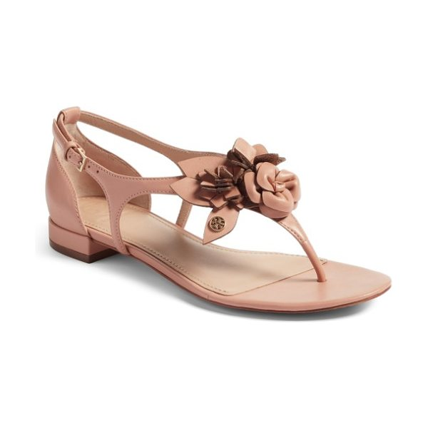 Tory Burch blossom sandal in light makeup - A polished Tory Burch medallion highlights the ornate...