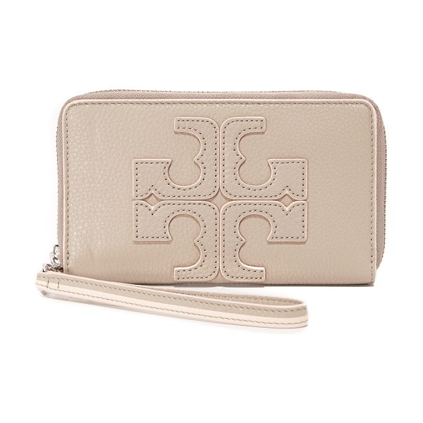 Tory Burch Contrast logo wristlet in french gray - A pebbled leather Tory Burch wallet with a logo accent...