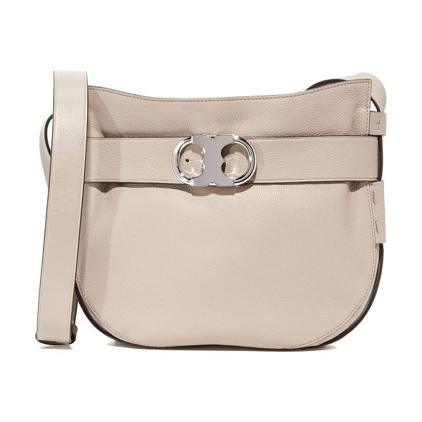 TORY BURCH gemini link cross body bag in french gray - A decorative belt with a polished logo buckle circles...