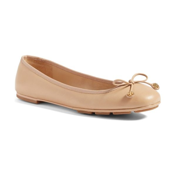 Tory Burch laila driver ballet flat in tory beige - A delicate ribbon featuring gleaming logo medallions...