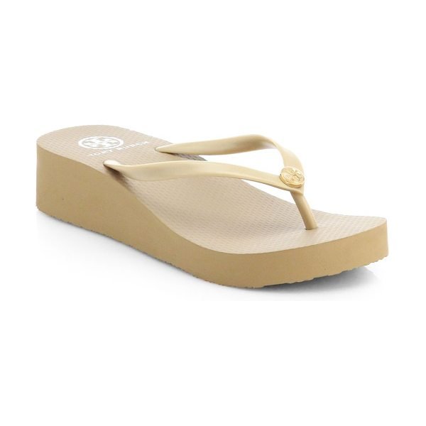 Tory Burch logo thong flip flops in khaki - Topped with a signature designer emblem, a traditional...