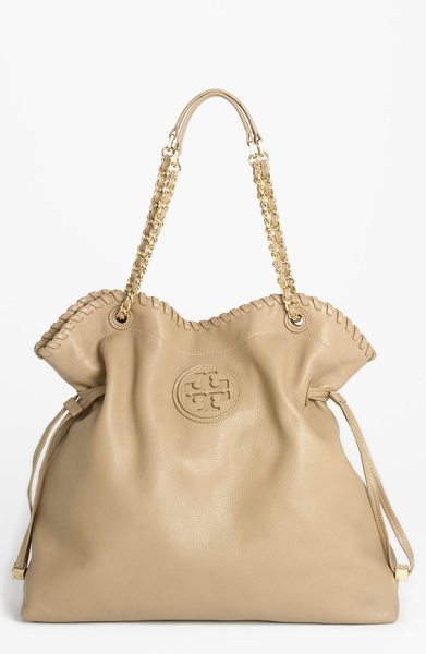 TORY BURCH Marion slouchy tote in tan - An upscale blend of bling and boho defines a spacious...