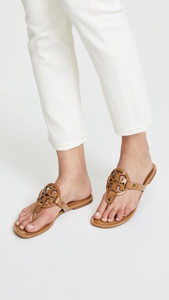 Tory Burch miller thong sandals in sand - A laser-cut logo adds a signature touch to these patent...