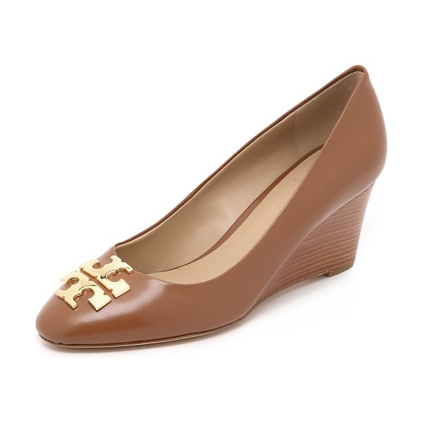 Tory Burch Raleigh wedges in tory beige/gold - Logo plates detail these timeless Tory Burch pumps....