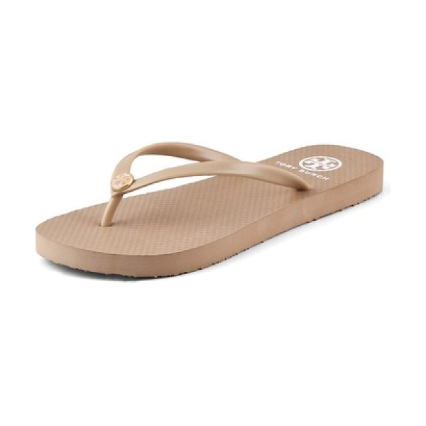 TORY BURCH thin flip flops - These rubber Tory Burch flip flops feature an enameled...