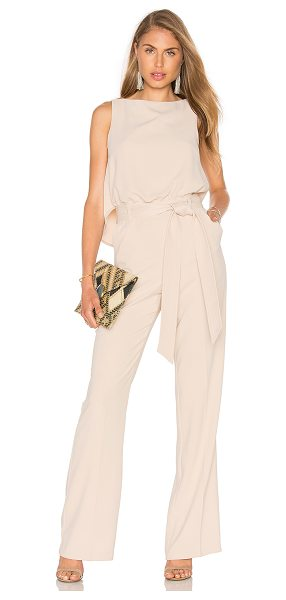 Trina Turk Epoch Jumpsuit in beige - Poly blend. Dry clean only. Waist tie. Front slant...