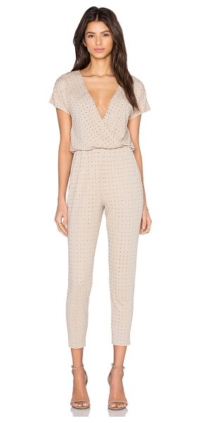 Trina Turk Jaxen Jumpsuit in tan - 70% rayon 30% poly. Dry clean only. Elasticized waist....