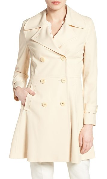 Trina Turk rosemarie skirted trench coat in cream - A weather-tough twill trench with notch-collar styling...