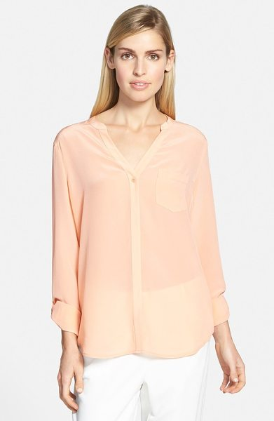 Trouve silk blouse in coral pink - A clean hidden placket and roll-tab sleeves contemporize...