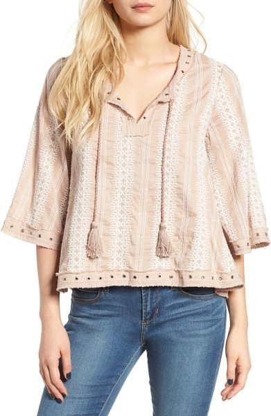 Tularosa huxley embroidered top in french mauve - Framed in grommets and threadbare trim, this swingy top...