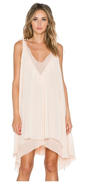 Tularosa Veda dress in peach - Poly blend. Fully lined. Mesh trim. Asymmetric hem....