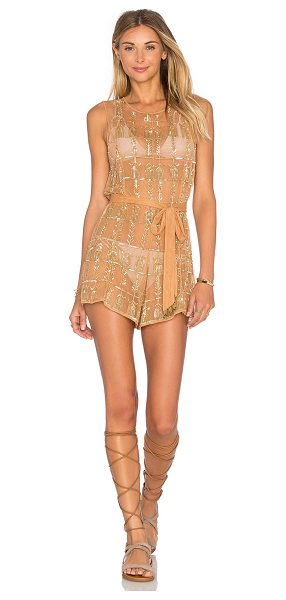 Tularosa x REVOLVE x Rocky Barnes Star Romper in metallic gold - 100% poly. Hand wash cold. Waist tie. Sequin detail...