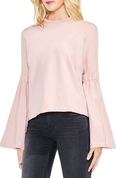 Two by Vince Camuto mock neck bell sleeve top in dusty blush - Boast an elegant silhouette in this stretch-knit top...