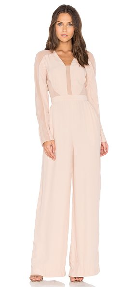 TY-LR The Catherine Jumpsuit in peach - Self: 100% viscoseCombo: 100% polyLining: 97% poly 3%...