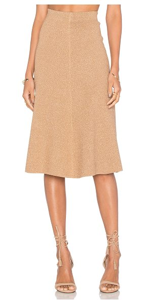 TY-LR The Magnitude Knit Skirt in metallic gold - 68% viscose 32% polyamide. Hand wash cold. Unlined....