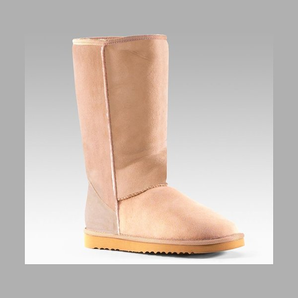 Ugg Classic shearling tall boots in sand - A timeless favorite of casual-chic style with a...