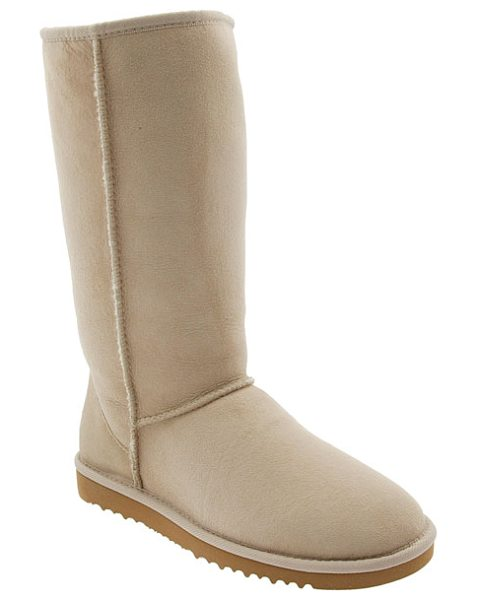 Ugg classic tall boot in sand - The iconic offering from UGG: a tall sheepskin suede...