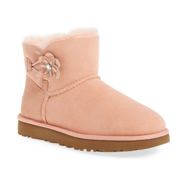 Ugg bailey petal genuine shearling lined mini boot in tropical peach suede - Studded flowers embellish the back of a fan-favorite UGG...