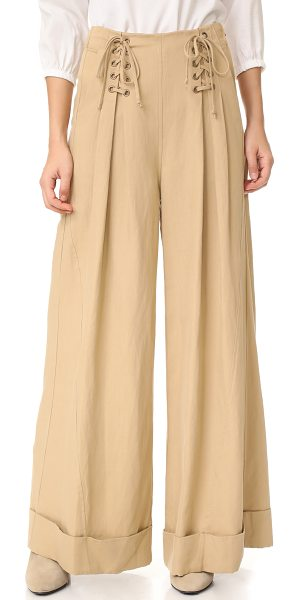 Ulla Johnson gaucho trousers in khaki - Ulla Johnson pants in a wide-leg profile. Lace-up ties...
