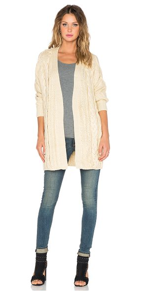 UNIF Reverb cardigan in beige - 100% acrylic. Dry clean only. Open front. Ribbed trim....