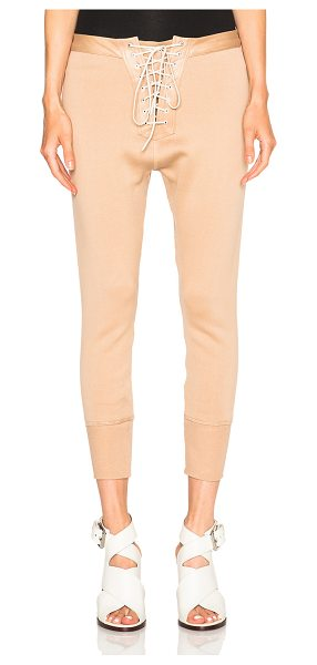 Unravel FWRD Exclusive Lace Up Leggings in neutrals - Self: 100% calfskin leather - Contrast Fabric: 100%...