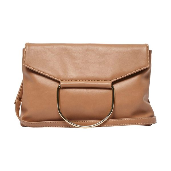 URBAN ORIGINALS on your radar vegan leather foldover bag in nude - A polished ring accents the fold-over flap of a...
