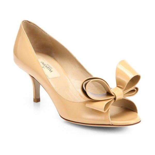 Valentino Couture patent leather bow pumps in beige - A signature bow adorns this peep-toe silhouette rendered...
