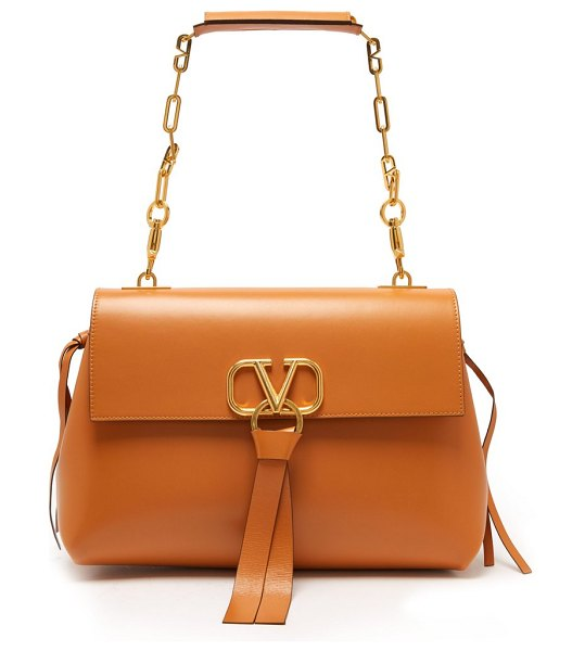 Valentino v ring medium leather shoulder bag in tan