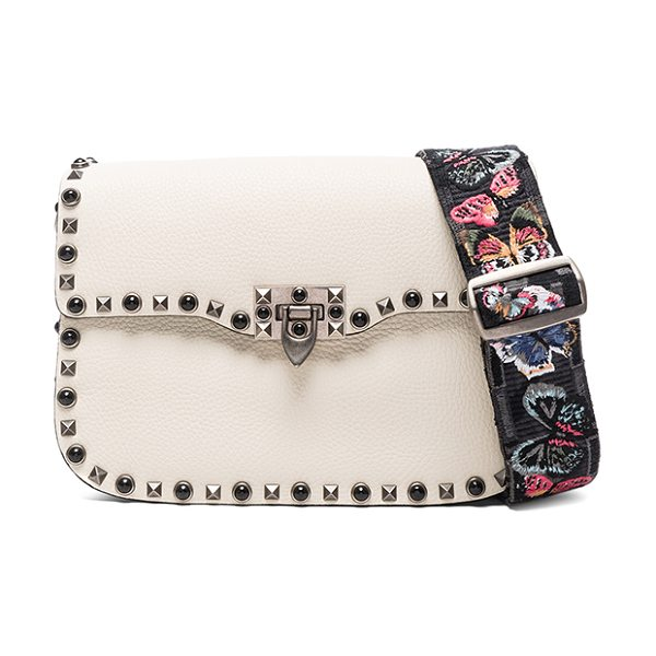 VALENTINO Guitar Rockstud Rolling Shoulder Bag in neutrals - Grained leather with raw lining and brushed silver-tone...