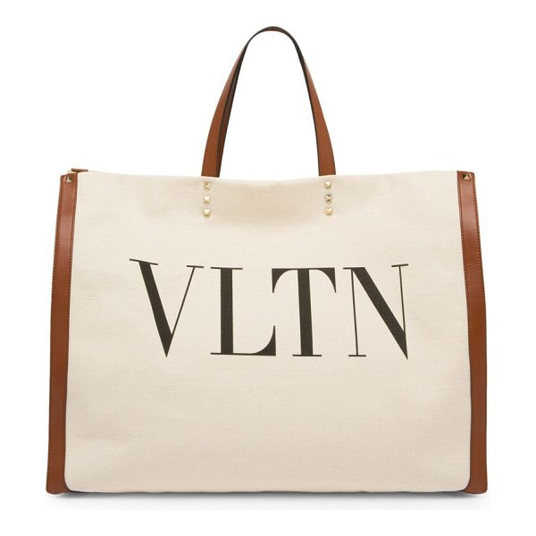 Valentino large vltn canvas tote in tan - Luxe canvas tote with leather trim features editorial...